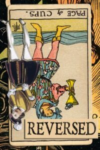 Read more about the article Reversed Page of Cups Meanings